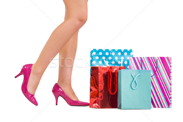 Womans legs in high heels with shopping bags Stock photo © wavebreak_media