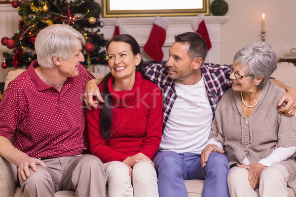 Portrait of a happy family sitting and speaking on sofa Stock photo © wavebreak_media