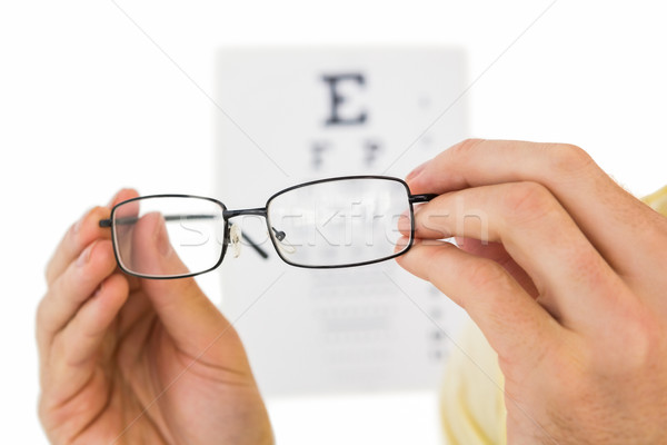 Glasses held up to read eye test Stock photo © wavebreak_media
