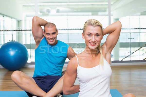 Couple stretching hands behind back in yoga class Stock photo © wavebreak_media