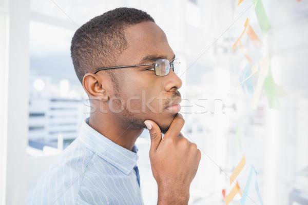 Thoughtful businessman reading sticky notes Stock photo © wavebreak_media