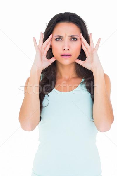 Pretty brunette with a headache Stock photo © wavebreak_media