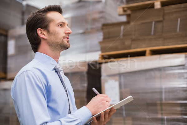 Serious warehouse manager checking inventory Stock photo © wavebreak_media