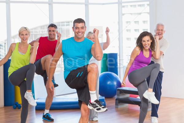 Mensen macht fitness oefening yoga klasse Stockfoto © wavebreak_media