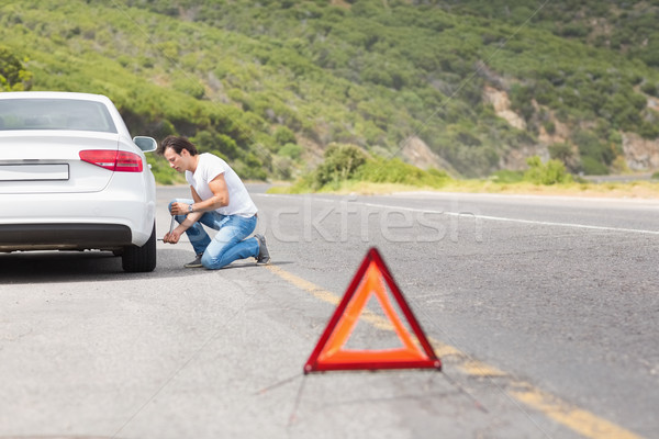 Man changing wheel after a car breakdown  Stock photo © wavebreak_media