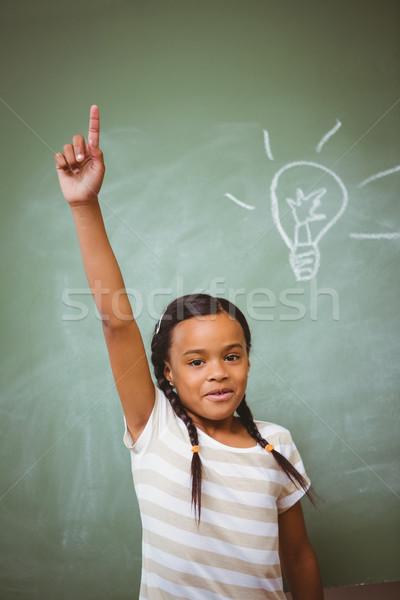 Little girl raising hand in classroom Stock photo © wavebreak_media