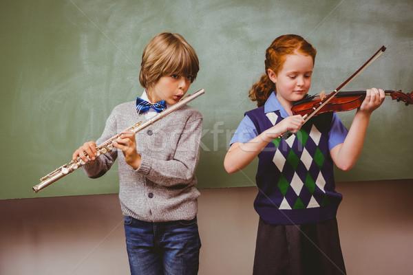 Diákok játszik furulya hegedű osztályterem portré Stock fotó © wavebreak_media
