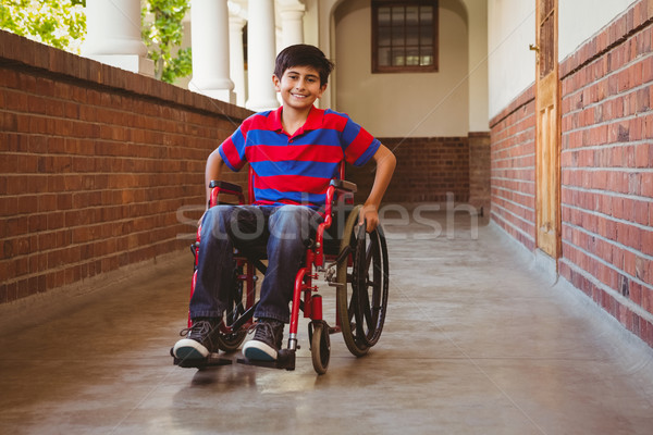 Boy sitting in wheelchair in school corridor Stock photo © wavebreak_media