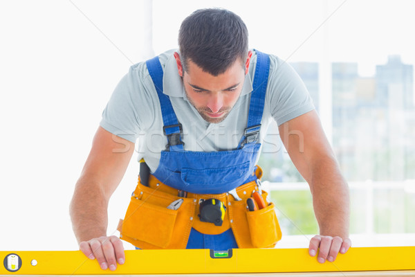 Carpenter using spirit level in office Stock photo © wavebreak_media