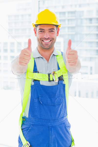 Worker wearing safety harness while gesturing thumbs up Stock photo © wavebreak_media