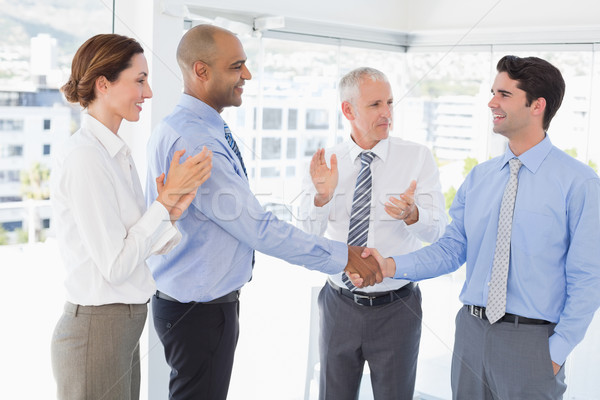 Business team congratulating their colleague Stock photo © wavebreak_media