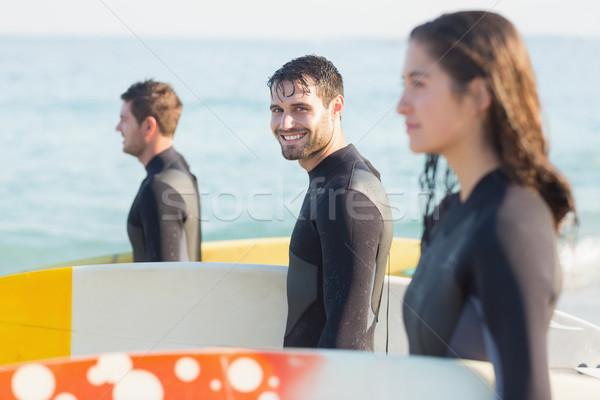Csoport barátok szörfdeszka napos idő tengerpart férfi Stock fotó © wavebreak_media