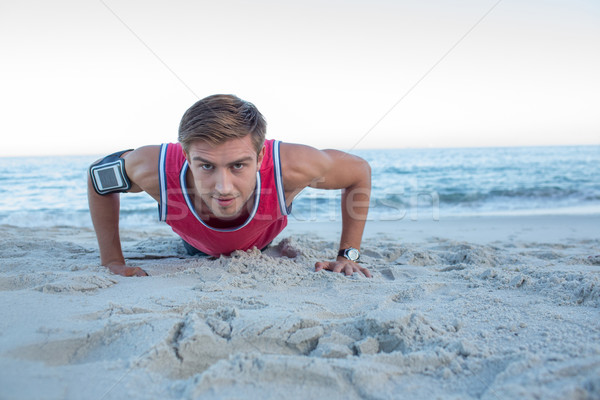 Handsome man doing push ups Stock photo © wavebreak_media