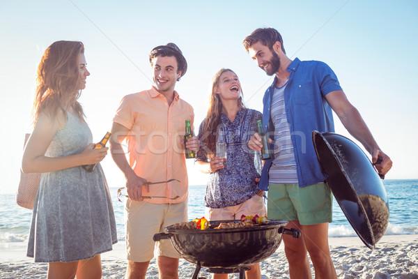 Boldog barátok barbecue iszik sör tengerpart Stock fotó © wavebreak_media