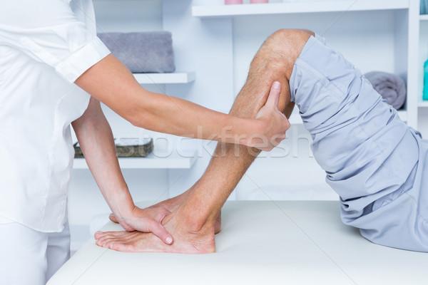 Physiotherapist doing calf massage to her patient Stock photo © wavebreak_media