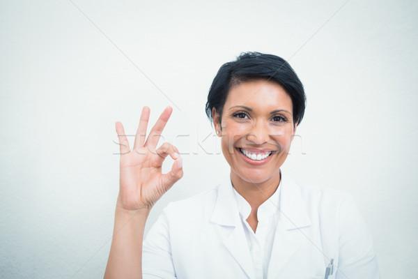 Souriant Homme dentiste ok signe Photo stock © wavebreak_media