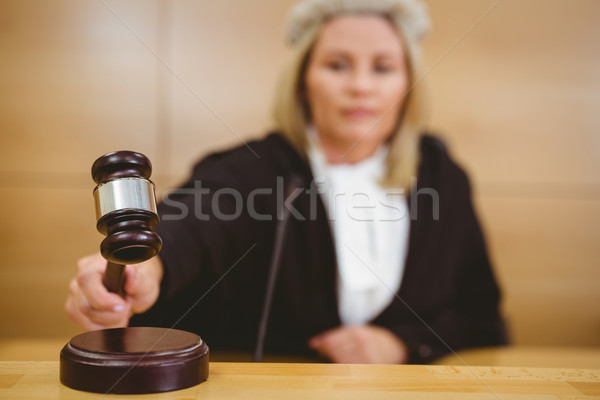 Serious judge with a gavel wearing robes and wig Stock photo © wavebreak_media
