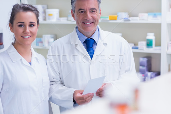 Pharmacist and his trainee looking at the camera Stock photo © wavebreak_media