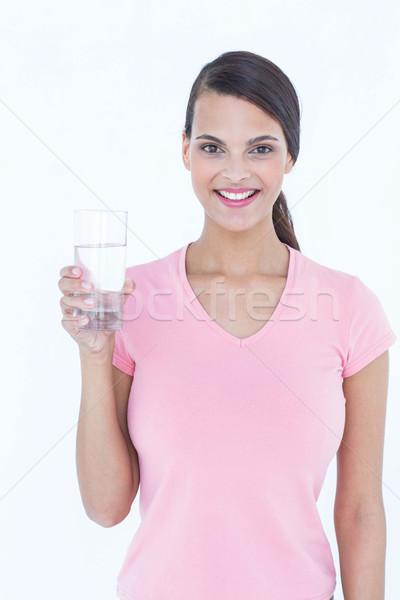 Beautiful woman drinking glass of water  Stock photo © wavebreak_media