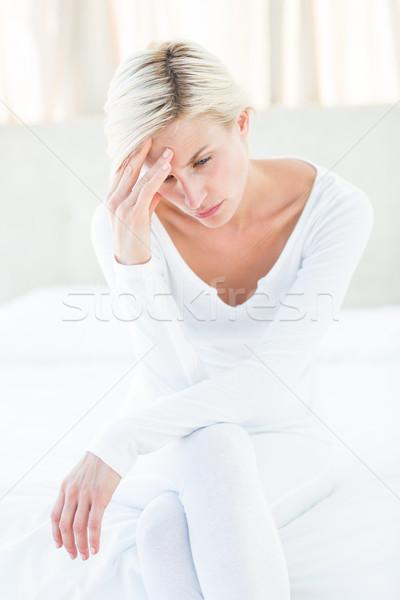 Endişeli sarışın kadın oturma yatak yatak odası ev Stok fotoğraf © wavebreak_media