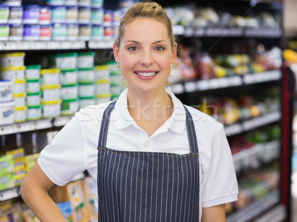 Portrait of a smiling blonde worker with hand on hip  Stock photo © wavebreak_media