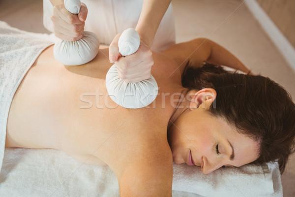 Young woman getting herbal compress massage Stock photo © wavebreak_media