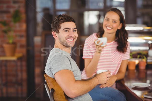 улыбаясь друзей сидят питьевой кофе портрет Сток-фото © wavebreak_media