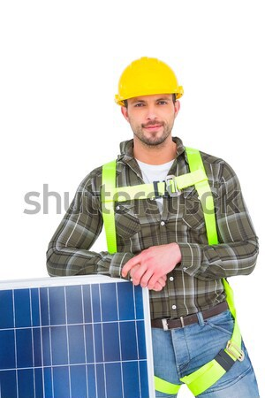 Composite image of smiling construction worker holding solar pan Stock photo © wavebreak_media