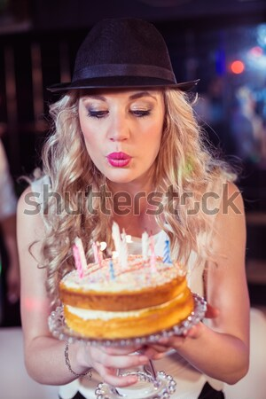 Composite image of woman blowing out candles Stock photo © wavebreak_media