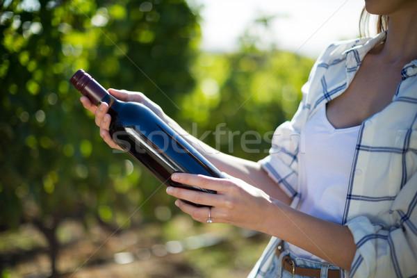 Mid section woman holding wine bottle at vineyard Stock photo © wavebreak_media