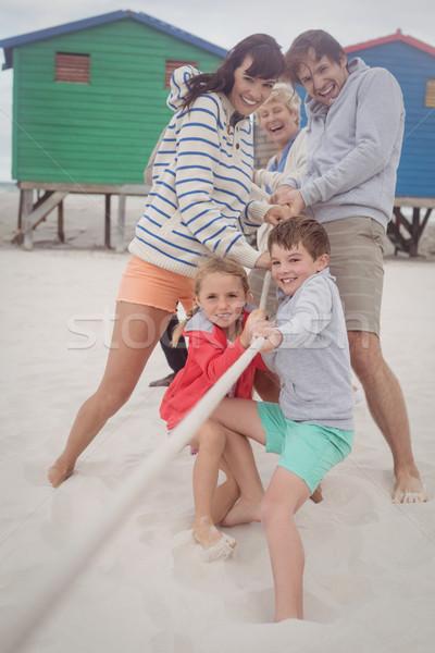 Happy multi-generation family playing tug of war Stock photo © wavebreak_media