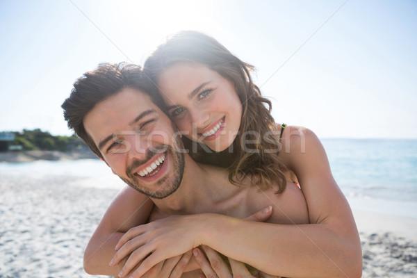 Portrait of happy shirtless couple embracing at beach Stock photo © wavebreak_media