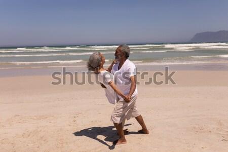 Hátsó nézet nő sétál fiú part tengerpart Stock fotó © wavebreak_media