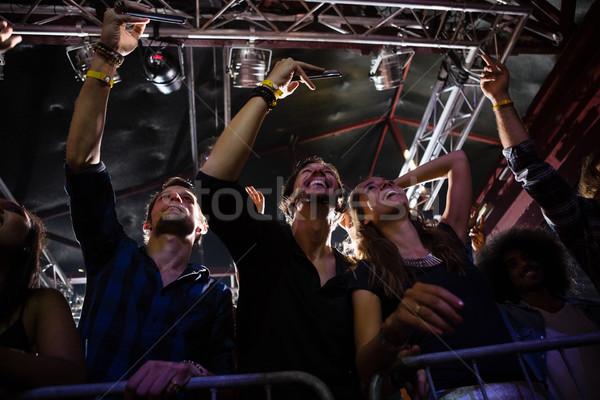 Tömeg néz elvesz fénykép előadó éjszakai klub Stock fotó © wavebreak_media