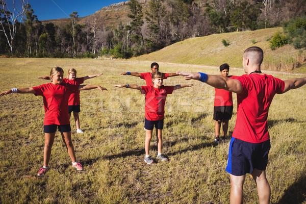 Trainer training kids in the boot camp Stock photo © wavebreak_media