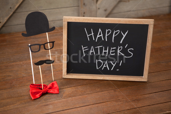 Anthropomorphic face by slate with happy fathers day text on table Stock photo © wavebreak_media
