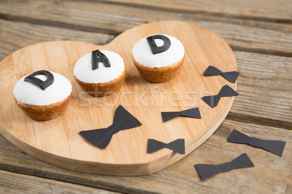 Close up of cupcakes with dad text by bow tie Stock photo © wavebreak_media