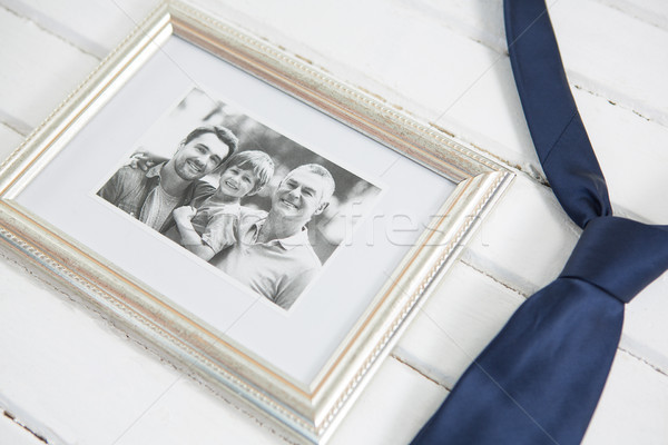 High angle view of photo frame with necktie Stock photo © wavebreak_media