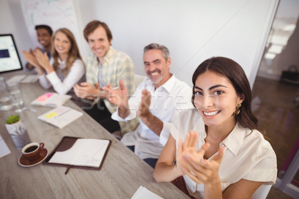 Smiling business people applauding during presentation in office Stock photo © wavebreak_media