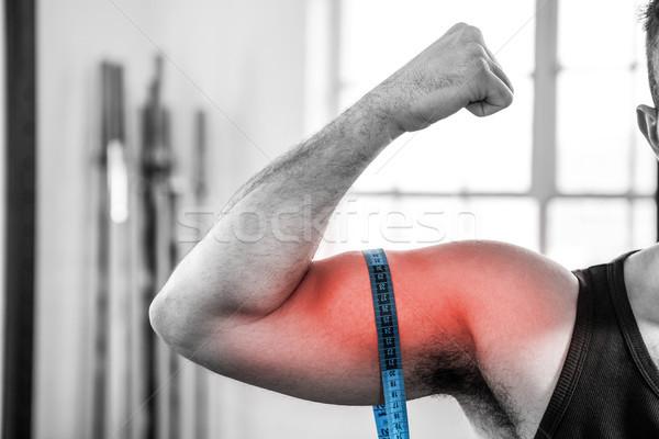 Bras homme biceps mètre à ruban composite numérique Photo stock © wavebreak_media