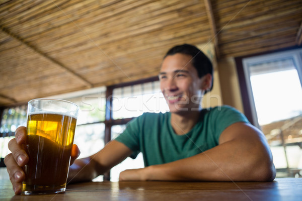 Stock photo: Smiling man with beer glass looking away