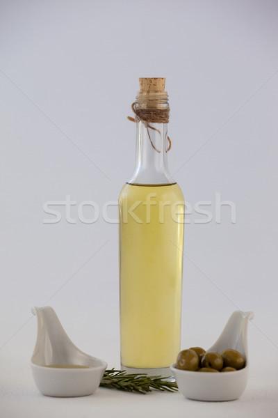 Olajbogyók gyógynövény olaj üveg asztal fal Stock fotó © wavebreak_media