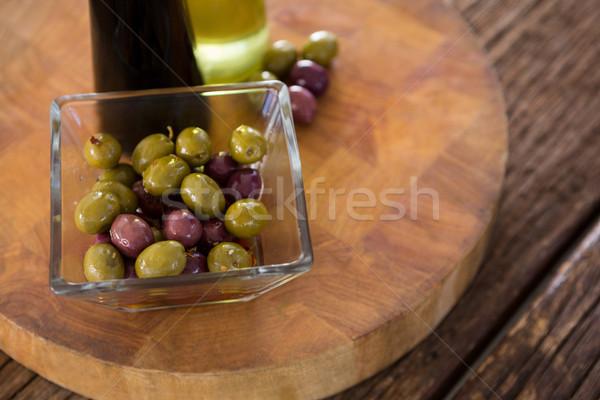 Marinated olives with olive oil and balsamic vinegar bottles on table Stock photo © wavebreak_media