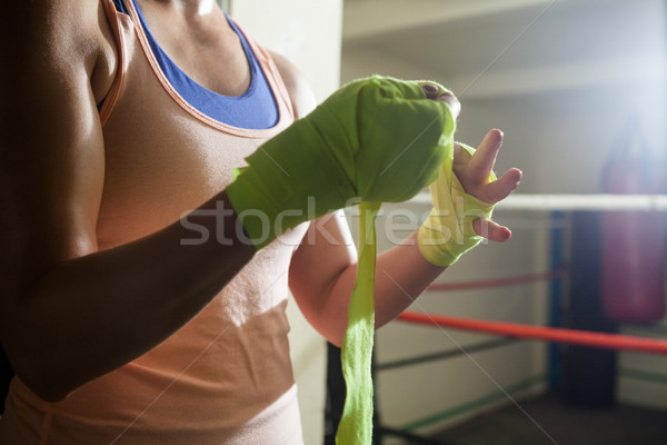 Mid section of woman tying hand wrap on hand Stock photo © wavebreak_media