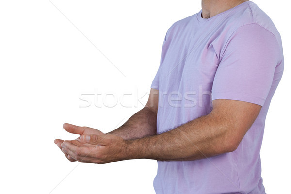 Mid section man with hands cupped holding invisible product Stock photo © wavebreak_media