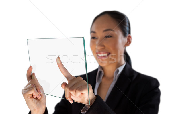 Smiling young businesswoman using glass interface Stock photo © wavebreak_media