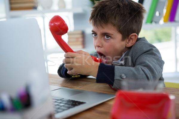 Fiú üzlet igazgató beszél telefon iroda Stock fotó © wavebreak_media