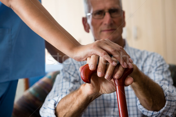 Close up of female doctor and senior man hands holding walking cane Stock photo © wavebreak_media
