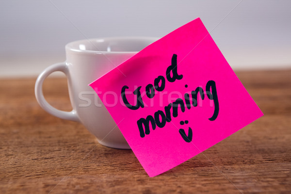 Close-up of black coffee with message on wooden plank Stock photo © wavebreak_media