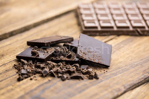 Peças chocolate mesa de madeira ver tabela Foto stock © wavebreak_media